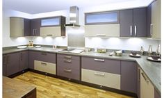 Purple Kitchen from Premier Kitchens. Matt Melanzana (a perfect purple) and Mocha have been used here to give a subtle addition of colour to the room. This simple design has a sophisticated feel that can be adapted to suit any kitchen regardless of shape or size. Combine the #modern design with softly #curved cupboards and you create a kitchen that is understated yet striking. Visit: http://www.premier-kitchens.co.uk/Premier-Kitchens-Kitchens/details/Alto-Matt-Melanzana-and-Matt-Mocha-BCAM