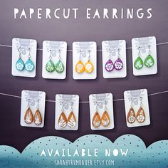 Papercut Earrings! Each pair of wooden earrings is made using a handcut paper illustration, cut by hand using an x-acto knife. Lots of designs available! By Sarah Trumbauer on Etsy