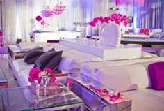 Splashes of bright fuchsia and royal purple infuse this crisp white lounge with energy and enthusiasm befitting the 25th anniversary of one of America's most celebrated ladies. Floral & Decor: KehoeDesigns.com, Photography: Ryan Sjostrom