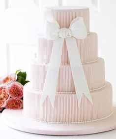 Blush Bow Wedding Cake - Modern embossed lines with an icing bow over four tiers. Bow Wedding Cakes, 4 Tier Wedding Cake, Wedding Bows, Beautiful Wedding Cakes, Beautiful Cakes, Amazing Cakes, Cupcakes, Cupcake Cakes, Bow Cakes