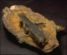 In June 1934, the Hahn family discovered a rock, sitting loose on a ledge outside of London, Texas. The site is of 75-100 million years old cretaceous rock. Noticing this rock had wood protruding from it, they cracked it open, exposing the hammer head...they cut into one of the beveled sides with a file. The bright metal in the nick is still there, with no corrosion. The unusual metallurgy is 96% iron, 2.6% chlorine and 0.74% sulfur (no carbon). Density tests indicate exceptional casting…