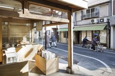 okomeya rice store by schemata enlivens tokyo shopping street Tokyo Shopping, Shopping Street, Shop Window Displays, Store Displays, Rice Balls, Design Blogs, Interior Design Magazine, Retail Space, Store Design