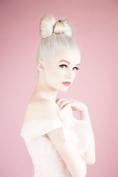 Porcelain princess, bow hair, perfect skin and soft makeup lush lashes, pale pink dress