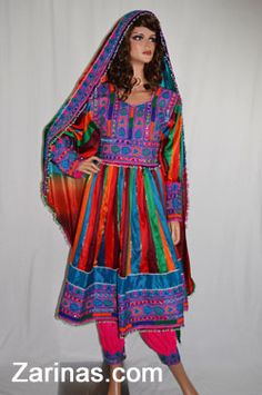 Stylish and colorful Afghan dress decorated with a unique embroidered pattern on the sleeves, skirt and chest area. The sleeves are fitted and straight, a new and fabulous style. Comes in fancy rainbow colors including a deep burgundy, blue, red, orange, green, and with a ravishing tie-dye scarf. Detailed to perfection with beads, mirrors, and colorful embroidery, this dress will surely be everything you could ever want in a trendy Afghan dress.  http://www.zarinas.com/dresses_fancy.shtml