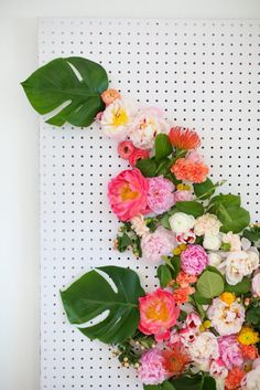 DIY Floral Photo Backdrop | lovelyindeed.com