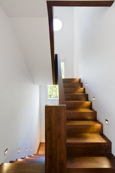 Crafted art stairs...love the gentle easy (but long) climb w/lights. Wondering what the room is like at the top? St Johns Wood - contemporary - Staircase - London - Gregory Phillips Architects