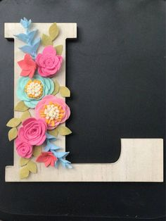 Personalize any occasion with this unique floral wall decoration. This is truly handmade, and each felt petal and leaf is hand cut, making each order unlike any other. The whitewashed letter offers a classy touch of charm that can celebrate your child, spouse, or friend. I can customize