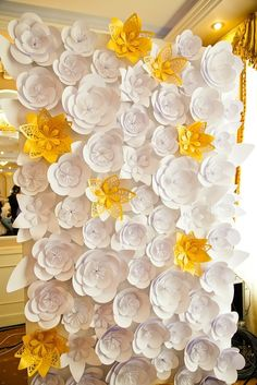 Who says you need a florist for a floral backdrop? These paper flowers prove that making your own can be just as beautiful and make for a super fun photo booth.