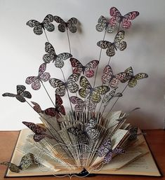 Visible Image Butterfly stamp Book Sculpture Consumers love the key benefits of e-books through traditional Recycled Book Crafts, Old Book Crafts, Book Page Crafts, Diy Arts And Crafts, Creative Crafts, Geek Crafts, Butterfly Books, Paper Butterflies, Butterfly Crafts