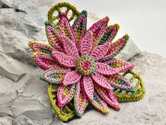 "This is a fine thread crochet daisy brooch which would be a perfect addition to your wardrobe. The flower itself measures 3"" (7.5 cm) wide and"