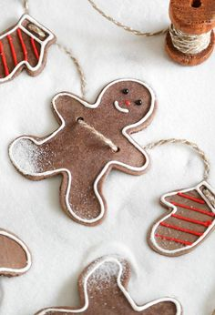 Whip up a sweet garland of smiling gingerbread Christmas ornaments with this tutorial by Heather Baird.