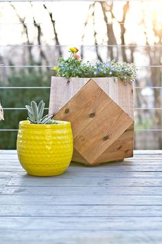 The wooden geometric planter was made from cedar fence posts. That's just one of the brilliant outdoor decor ideas in this deck makeover by Sarah Dorsey of Sarah M. Dorsey Designs. See it on The Home Depot Blog. || @smdorsey