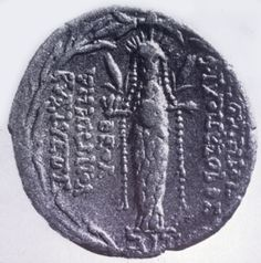 This coin shows Aphrodite of Aphrodisias, another pillar goddess whose temple was in southwestern Turkey. This depiction somewhat resembles a bee, or a bundle. Aphrodite too wears the feather crown (which originated with her forebears, Ashtart of Canaan and Atargatis, Dea Syria) and is flanked by the ears of grain.