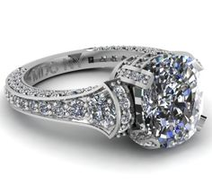 Large Cushion Diamond Cathedral Graduated pave Engagement Ring