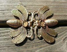 NOT THE BEES! Cloak Clasps, $40. These --- weight clasps are ready for setting with your choice of gem. The double stitch holes on the wings will keep them safe while you are adventuring. Designed to be a secure closure for every day wear, LARPing, Highland games, Renaissance events, rituals, or any other place that you would wear your favorite cloak.