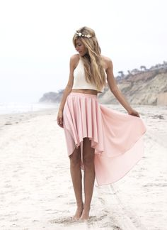 a beautiful white crop top and a gorgeous light pink high low skirt. the hair is stunning in this picture