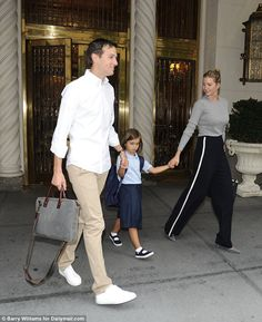 Added touches: The little girl also wore a large navy backpack and black Mary…