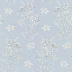 Ett ljust romantiskt mönster i en blå-beige färgställning som för tankarna till sekelskiftet och ger ett mjukt och ombonat intryck.