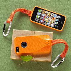 "$30  SPEAK EASY IPHONE 5 CASE -- Impact proof case in easy-to-spot orange with lanyard and carabiner to keep your iPhone at hand during all your outdoor adventures. Nylon/plastic. USA. 4-1/2""W x 1""D x 8""H."