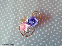 A sweet pastel floral brooch