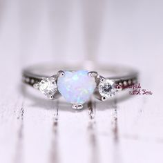 Hey, I found this really awesome Etsy listing at https://www.etsy.com/listing/252327771/white-opal-ring-silver-lab-opal-ring