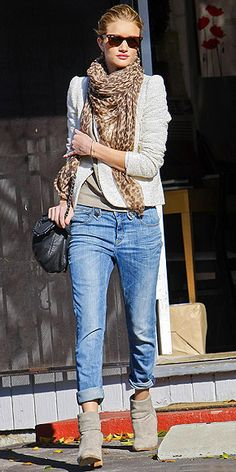 Boyfriend jeans with ankle booties and a scarf.