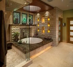This zen bathroom is full of beautiful custom touches, from the waterfall tub to the circular skylight! What custom upgrades are on your list for your dream home?