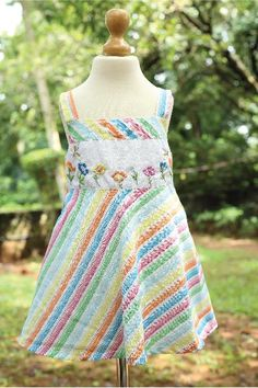 This 100% cotton fabric has an umbrella cut with strappy sleeves and embroidery on the yoke. The multi coloured strips with silver lining adds a vibe to the dress.