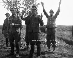 Waffen-Sturmbannführer Paul Maitla (second from left), Waffen-Hauptsturmführer Arved Laasi (second from right) with three other Estonian Waffen-SS soldiers defiantly faced their captors moments before being executed. Czechoslovakia. 10 May 1945.
