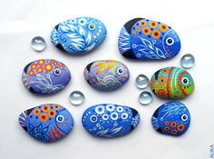 Painted rock stone art  blue fish magnet. $14.00, via Etsy.