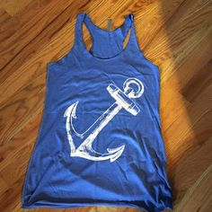 Blue Anchor tank New - never worn!  Fun anchor tank for the summer and hanging at the beach! Next Level Tops Tank Tops
