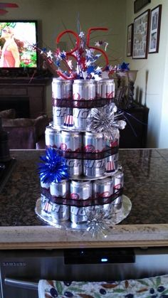 Just did this awesome beer can cake for my hubby from an idea from Pinterest !!