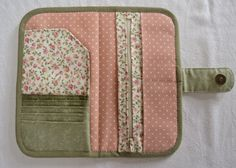 Inside wallet with complementary colors and snap closure.