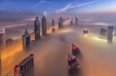 Find yourself surrounded by fog when standing on the roof of a #skyscraper - possible?  Well, yesterday and only once more a year in the transformed cloud city of #Dubai ! #sci-fi