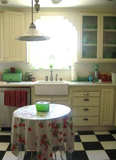 Farm sink, glass cabinets to showcase vintage beauty + little vintage accents on the counter. *heart melts*