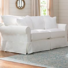 Offer a plush touch to your living room or den ensemble with this understated cotton sofa, the perfect piece to anchor your entertainment space. Punch up the feminine flair with scrolling cabriole chests and tables around the room, then add in stitched floral ottomans and pierced ceramic garden stools to round out the look.