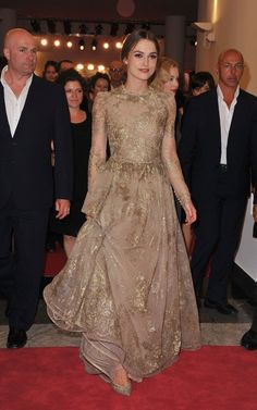 Keira Knightley wearing Valentino Fall 2011 Hc Gold Sheer Gown and Valentino Fall 2011 Hc Pumps.