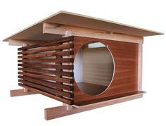 If you're serious about modern architecture, then you're going to flip for this beautiful modern cat house. Created by Tom Davies of Davies Decor, this modern cat hideaway is designed with classic post and beam principles, horizontal lines and a.