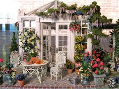miniature garden..you have to check out the birdhouses and the butterflies on the flowers..m m..