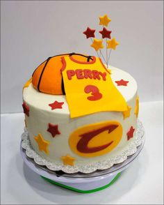 "Basketball birthday cake with Cavaliers theme: 10"" buttercream iced 3-layer cake with fondant-covered half basketball cake and fondant details"