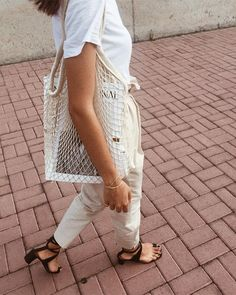 Fishnet bag. Favorite summer outfit | casual outfit | minimal outfit | simple outfit | comfy outfit | summer vacation outfit | summer travel outfit | summer street style | simple holiday outfit | pared down holiday looks | minimalist summer fashion | minimalist summer outfit ideas