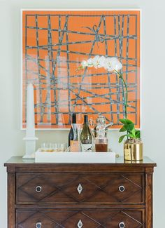 An Hermes scarf was framed and made for a stunning piece of art above the bar, which sits atop this gorgeous wood dresser. (via elements of style)