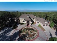Cathedral Pines , Colorado Springs Stunning Home For Sale $4,000,000 Total Sqft:16,180Baths:10Beds: 6 the ideal combination of luxury, entertainment, privacy and convenience. This luxury estate sits secluded on 51 beautiful acres in Cathedral Pines with fabulous Pikes Peak views. Accessibility to I-25 is a short 10 minute drive. Play in the indoor pool, two story slide, or workout in the large exercise room. Then take some time for yourself to relax in the indoor hot tub or watch a movie
