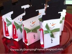 WEDNESDAY, DECEMBER 19, 2012 My Stamping Friends: Snowman Candy Holder using Stylin' Snowfolk from Stampin' Up! and my Big Shot | Two Tags die for the snowman base; modern label punch and curly label punch for his hat. Stylin' Snowfolk face and buttons. Finish off with a 3/8 inch stitched satin ribbon in gumball green as his scarf, stick the kit-kats inside and seal it up.