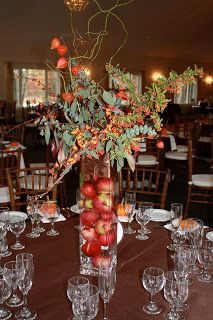 tall centerpieces with locally grown apples and Chinese lanterns (those are the orange pumpkin like flowers int he centerpieces)