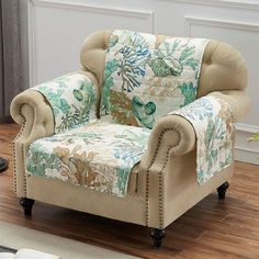 Make waves with seahorses, coral, and seashells Under the Sea. These polyester furniture covers have printed sea life designs in shades of warm green, light brown, dark blue, and ecru. Each furniture cover has box quilting and bound ends and is reversible to a ticking stripe design in turquoise, light brown, russet, and ecru. Loveseat Covers, Armchair Slipcover, Furniture Slipcovers, Slipcovers For Chairs, Furniture Covers, Coastal Furniture, Home Furniture, Furniture Design, Armchair Protectors