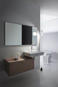 Patented by Swiss manufacturer Laufen, SaphirKeramik is a super-strong ceramic material that can be shaped into impossibly thin geometric forms (think porcelain without the fragility). Laufen brought Munich-based designer Konstantin Grcic on board. Laufen Bathroom, Bathroom Toilets, Bathroom Sets, Bathroom Storage, Bathrooms, Small Sink, Wall Mounted Vanity, Bathroom Collections, Vanity Units