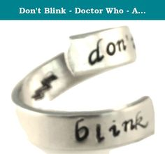 "Don't Blink - Doctor Who - Adjustable Aluminum Wrap Ring. This Doctor Who inspired ""Don't Blink"" aluminum wrap ring is hand stamped with care, one letter at a time. Stamped on the inside of the ring is a lightning bolt. The rings are made out of Pure 1100 Aluminum, which is food safe and does not tarnish. They contain no Zinc or Magnesium which are often found in common aluminum and can cause skin reactions. This also means it doesn't contain the properties of other metals that might…"