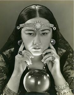 This is how an imagined 1930s   Gypsy fortune teller looks.   Note the four-leaf clover earrings.