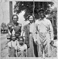 Proud African American Family notice the smiles. Jim Crow did try to spoil this to no avail.
